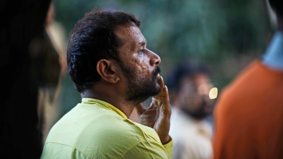 A supporter of Hindu hardline Shiv Sena party leader Bal Thackeray grieves outside his house after his death was made public in Mumbai, India, Saturday, Nov. 17, 2012. (AP / Rafiq Maqbool)