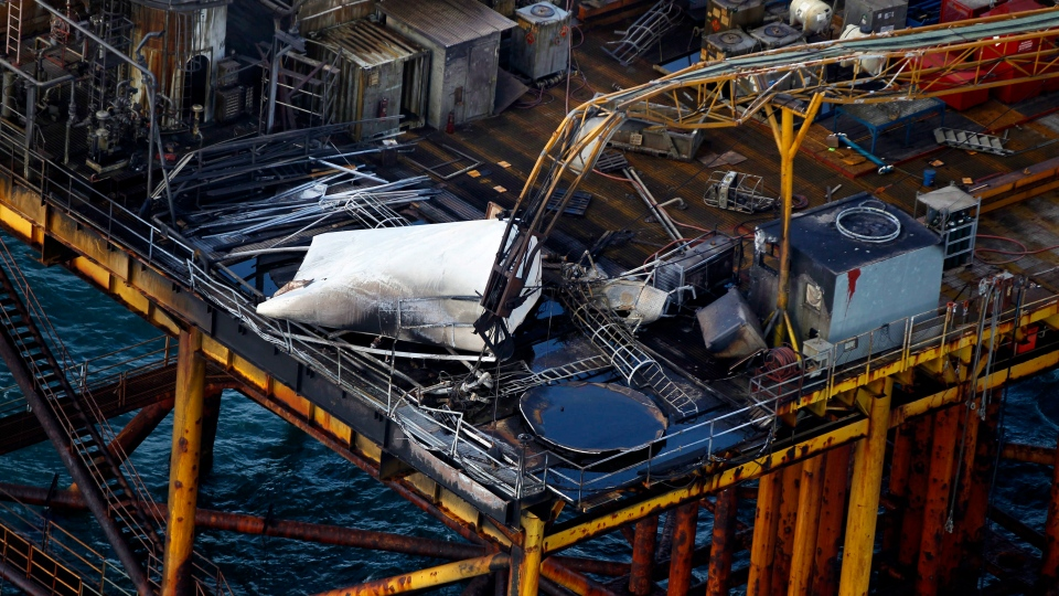 This aerial photograph shows damage from an explosion and fire on an oil rig in the Gulf of Mexico, about 25 miles southeast of Grand Isle, La., Friday, Nov. 16, 2012. (AP / Gerald Herbert)