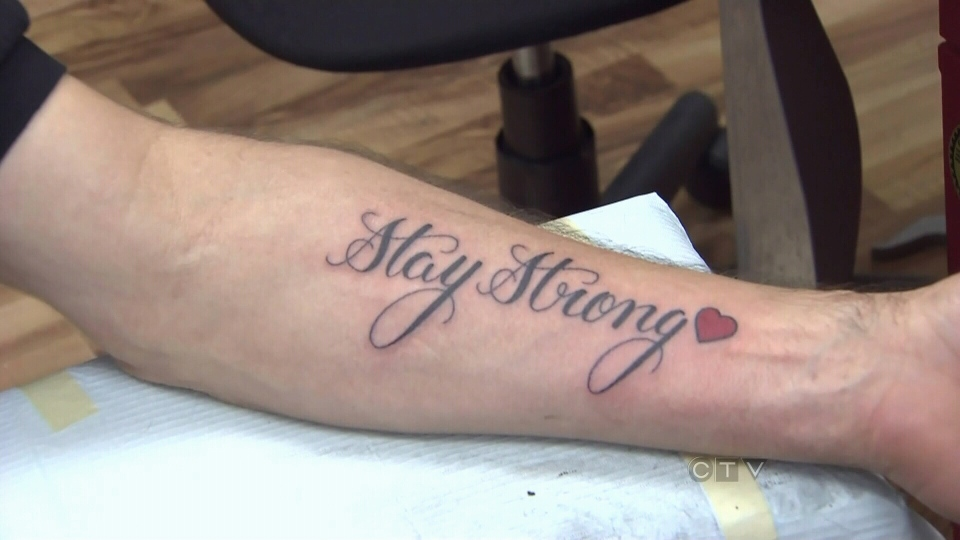Amanda Todd's father gets a tattoo on his forearm that reads 'Stay Strong' to remember his daughter.