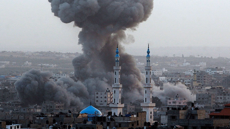 Smoke rises after an Israeli forces strike in Gaza City, Saturday, Nov. 17, 2012.  (AP / Hatem Moussa)
