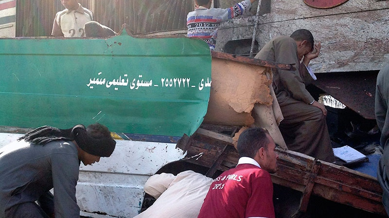 Distraught Egyptians searched for signs of their loved ones in the wreckage of a train crash that killed at least 47 people, most of them children near Assiut in southern Egypt, Saturday, Nov. 17, 2012. (AP / Mamdouh Thabet)