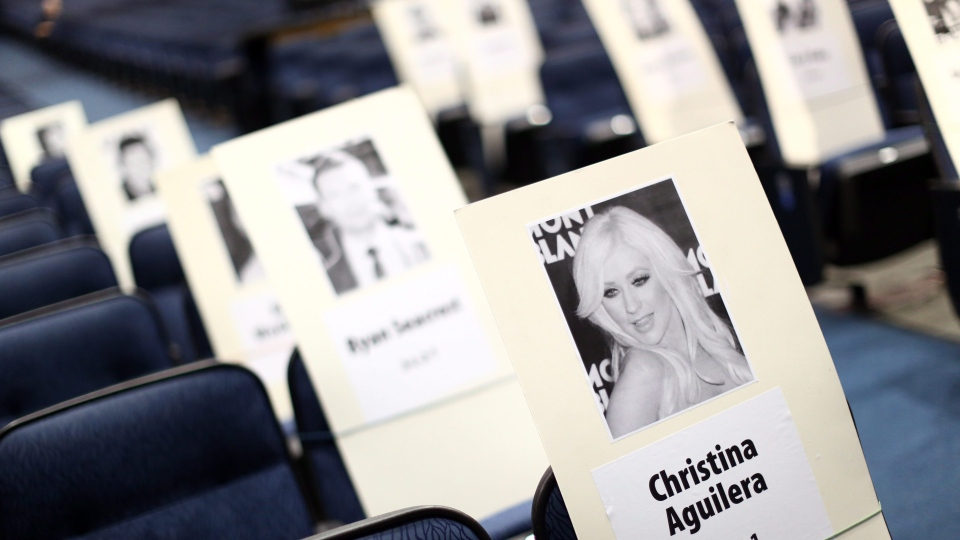 Seating placards, including one for singer Christina Aguilera, are displayed for the American Music Awards at the Nokia Theatre on Thursday, Nov. 15, 2012, in Los Angeles. The American Music Awards will be held on Sunday. (Photo by Matt Sayles/Invision/AP)