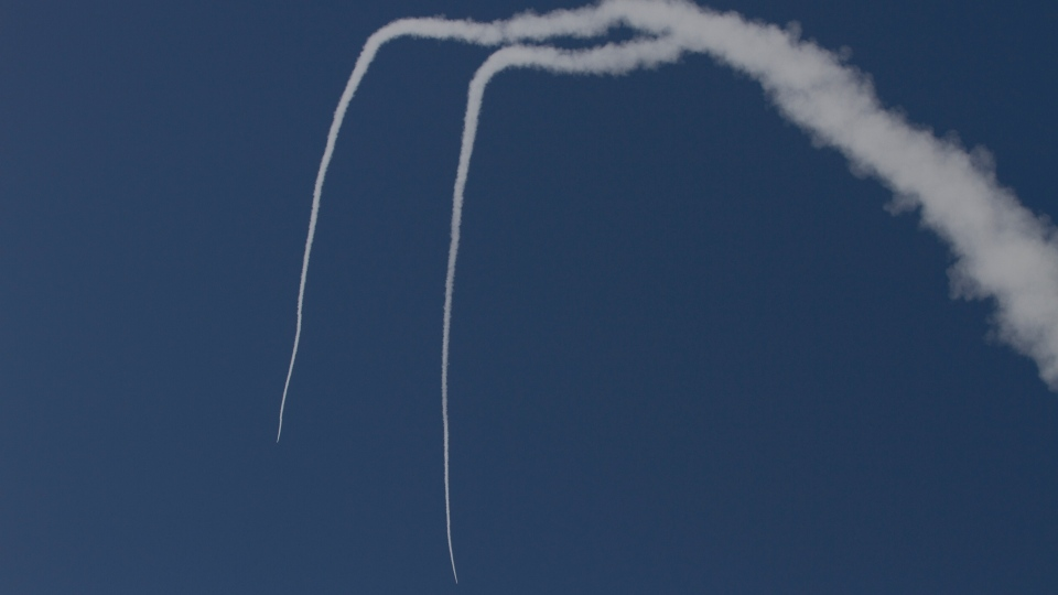 Two Iron Dome missiles launched near the city of Ashdod, Israel to intercept a rocket fired by Palestinians militants from Gaza Strip on Sunday, Nov. 18, 2012.  (AP / Ariel Schalit)