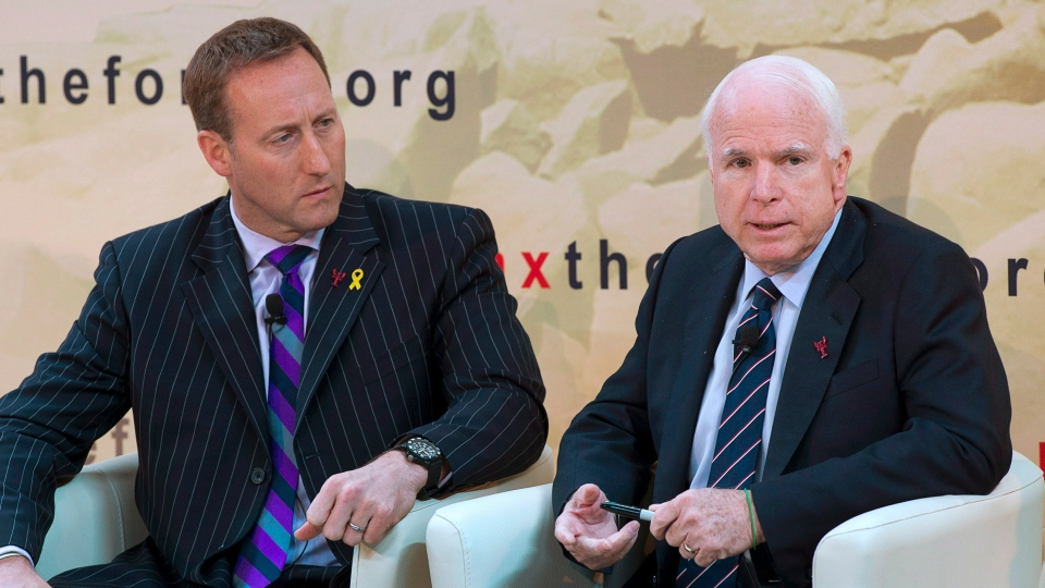 Canadian Defence Minister Peter MacKay, left, listens as United States Senator John McCain fields a question at the Halifax International Security Forum in Halifax on Saturday, Nov. 17, 2012. (Andrew Vaughan / THE CANADIAN PRESS)