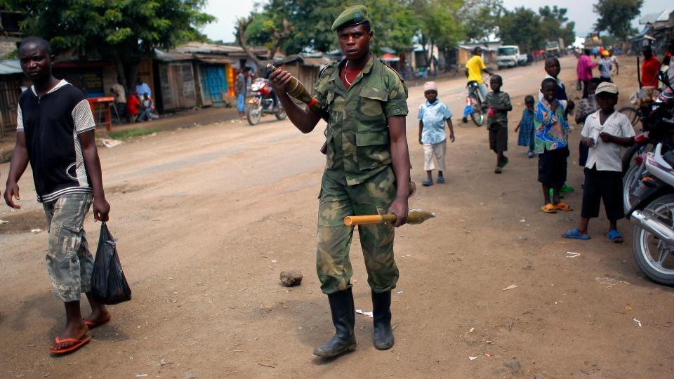 An M23 rebel walks the streets of the North Kivu town of Rubare near Rutshuru, 75 km north of Goma, Congo on Aug. 5, 2012. (AP / Jerome Delay)