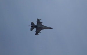An armed Israeli F-16 jet fighter on route to Gaza Strip, flies over the area where the Iron Dome missile system is deployed near the city of Ashdod, Israel on Sunday, Nov. 18, 2012. (AP / Ariel Schalit)