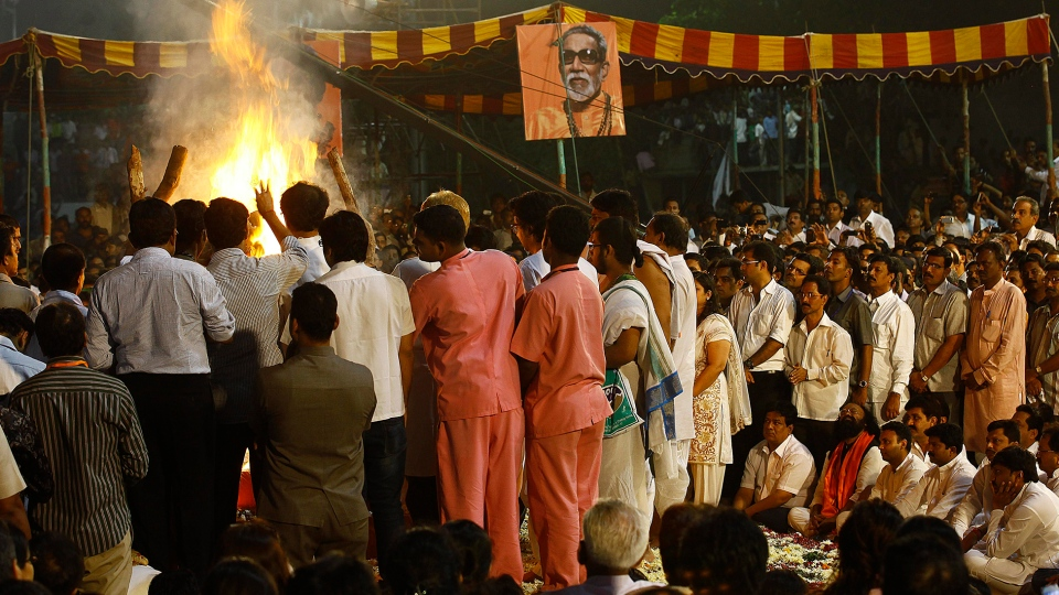 People attend the cremation of Hindu hardline Shiv Sena party leader Bal Thackeray in Mumbai, India, Sunday, Nov. 18, 2012. (AP / Rafiq Maqbool)