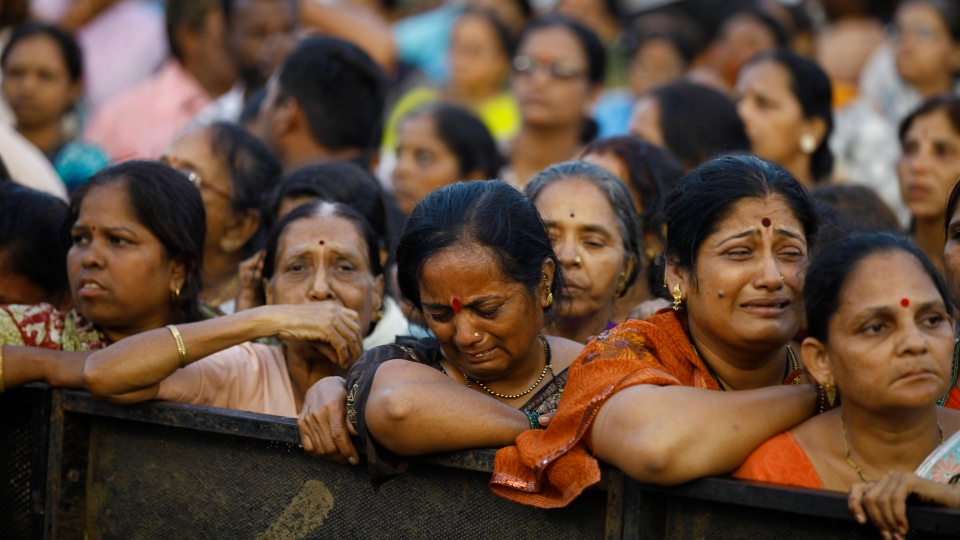 Supporters wail during the cremation of Hindu hardline Shiv Sena party leader Bal Thackeray in Mumbai, India, Sunday, Nov. 18, 2012. (AP / Rafiq Maqbool)