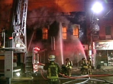 Firefighters battle a fire on Queen Street in downtown Toronto on Wednesday, Feb. 20, 2008.