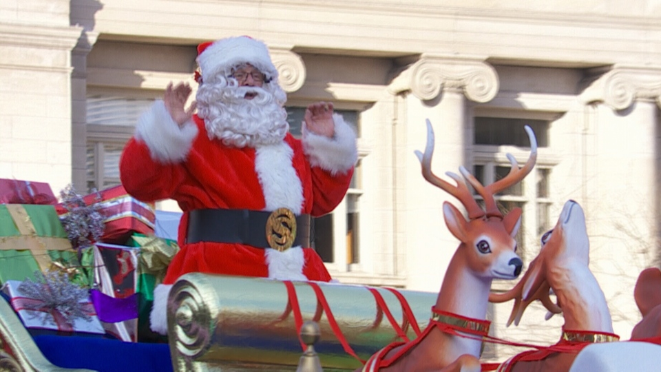 Santa waves to the crowds at the 108th Annual Santa Claus Parade in Toronto on Sunday, Nov. 18, 2012.