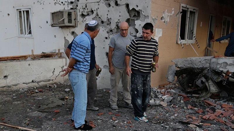 Residents inspect the damage at a house after a rocket fired by Palestinian militants from inside the Gaza Strip, landed at the community of Ofakim, in southern Israel, Sunday, Nov. 18, 2012. (AP / Lefteris Pitarakis)