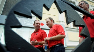 Team Canada head coach Brent Sutter, right, and assistant coach Peter Deboer arrive for a reception at the Canadian embassy in Moscow on Saturday, August 25, 2007. (Paul Chiasson / THE CANADIAN PRESS)