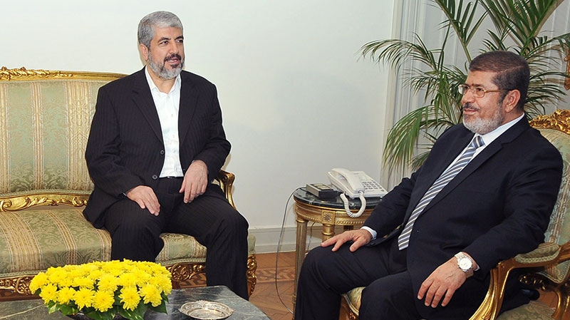 In this image provided by the Egyptian President, Hamas leader Khaled Mashaal, left, meets with Egyptian President Mohammed Morsi at the Presidential Palace in Cairo, Sunday, Nov. 18, 2012. (AP / Egyptian Presidency)