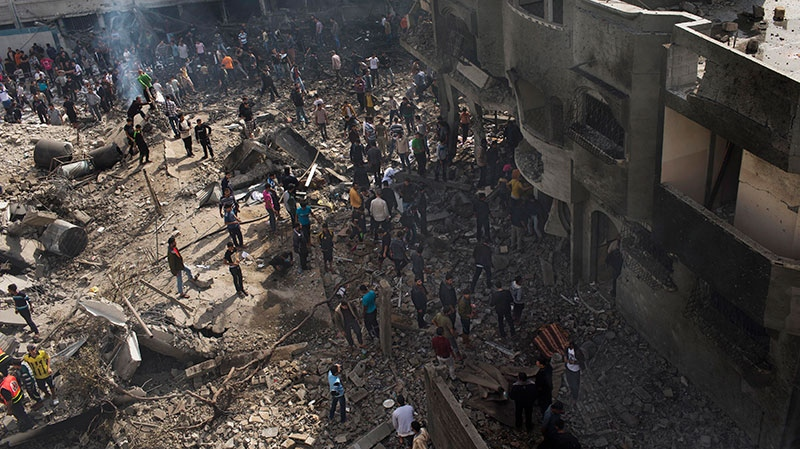 Palestinians inspect the damage of an Israeli forces strike in Gaza City, Sunday, Nov. 18, 2012.  (AP / Bernat Armangue)