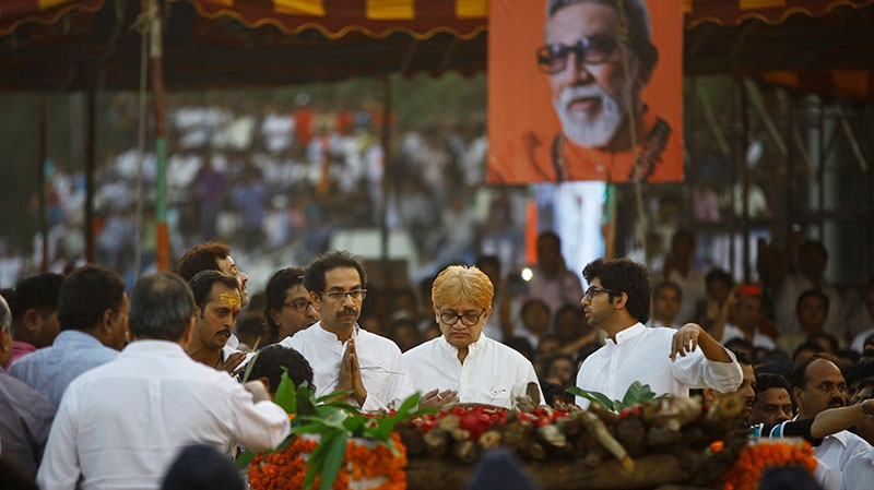 Son and successor, Uddhav Thackeray, center left with folded hands, prays during the cremation of Hindu hardline Shiv Sena party leader Bal Thackeray in Mumbai, India, Sunday, Nov. 18, 2012. (AP / Rafiq Maqbool)
