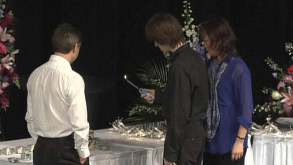 Candles are lit at the beginning of the 'Celebration of Life' service for Amanda Todd, by her brother and mother, at the Red Robinson Show Theatre in Coquitlam, B.C. on Sunday, Nov. 18, 2012.