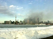 Smoke billows across the Toronto skyline after a massive fire on Queen Street West on Wednesday, Feb. 20, 2008.