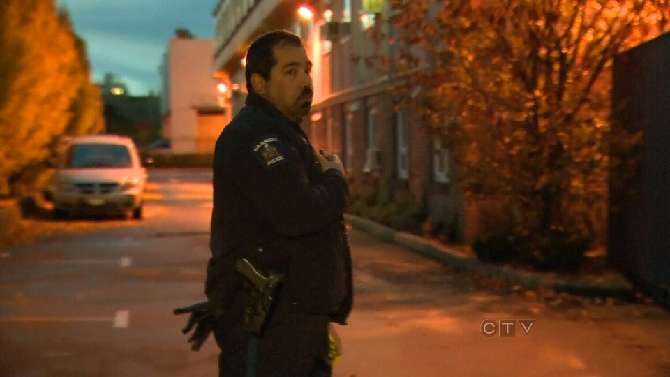 A police officer guards the scene of several stabbings in Saanich, B.C., Sunday, Nov. 18, 2012.