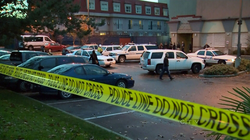 Police vehicles fill the parking lot of the Red Lion Inn and Suites in Saanich, B.C., on Sunday, Nov. 18, 2012.