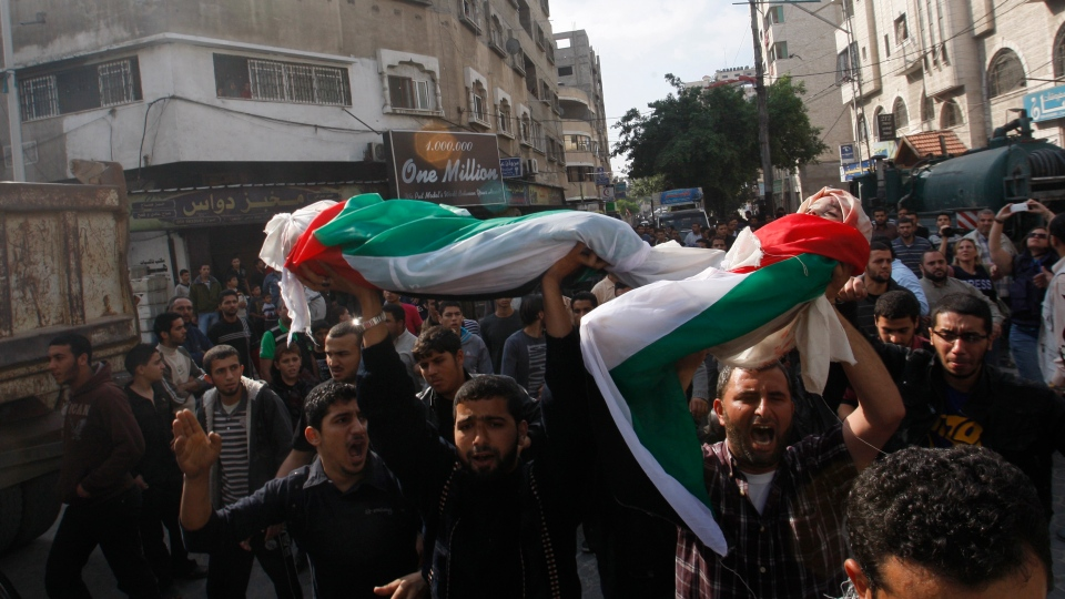 Palestinians carry bodies of members of the Daloo family during their funeral in Gaza City, Monday, Nov. 19, 2012.  (AP / Hatem Moussa)