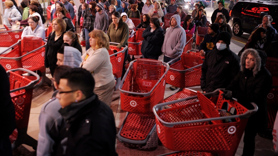 A crowd of shoppers wait outside the Target store before the store opens for Black Friday shopping at midnight in Lisbon, Conn., Friday, Nov. 25, 2011. (Sean D. Elliot / The Day)