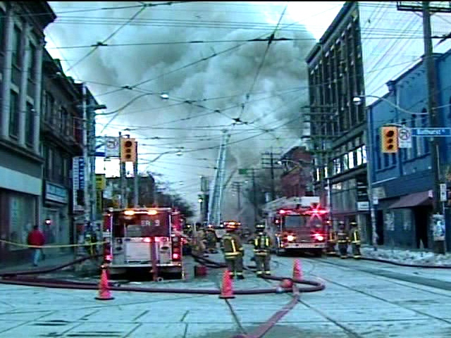 Smoke billows across Queen and Bathurst during the massive fire in downtown Toronto on Wednesday, Feb. 20, 2008.