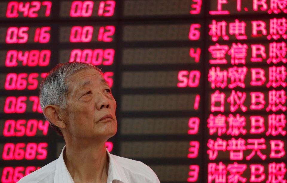 An investor in Shanghai, China looks at the stock price monitor at a private securities company in this September 2012 file photo. (AP Photo)