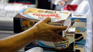 A cashier rings up boxes of Hostess Twinkies in Denver on Friday Nov. 16, 2012. (AP Photo/Brennan Linsley)