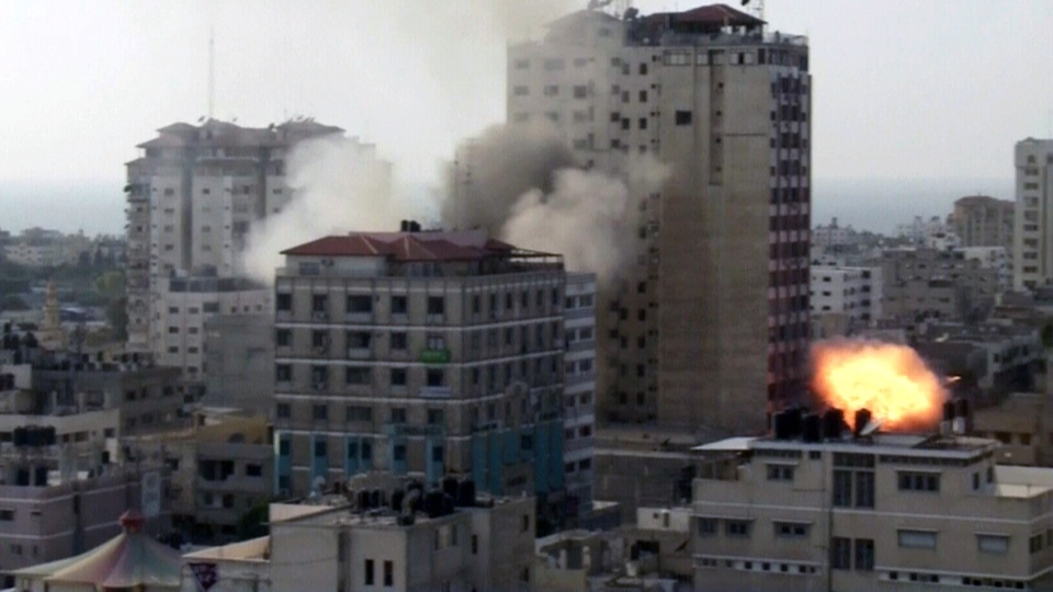 An explosion rocks a building in Gaza as Israeli missiles continue to strike, Monday, Nov. 19, 2012.