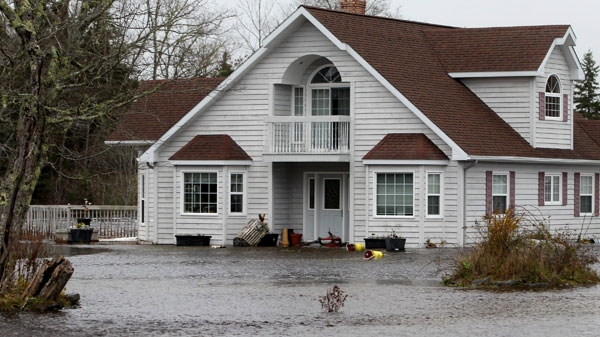 A house along the Clyde River is partly submerged, as flood waters continue to surge after several days of heavy rain hit the province in South Western Nova Scotia on Tuesday, November 9th, 2010.  (Mike Dembeck / THE CANADIAN PRESS)