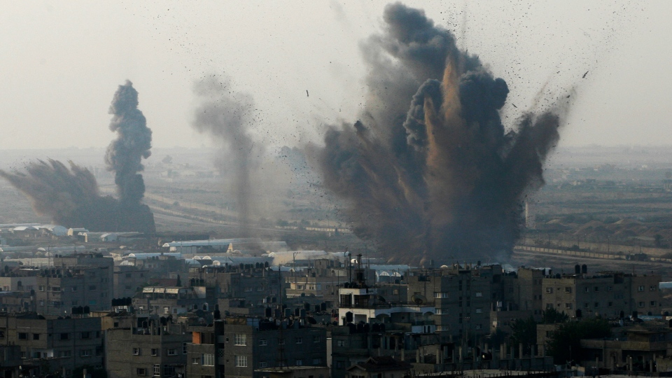 Smoke rises following an Israeli attack on smuggling tunnels on the border between Egypt and Rafah, southern Gaza Strip, Monday, Nov. 19, 2012. (AP / Eyad Baba)