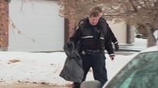 A Saskatoon police officer carries away the carcas