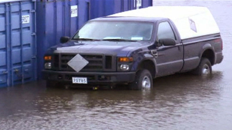 A car is seen surrounded by flood waters in Lower Sackville, N.S. (Rob Sargeant / MyNews.CTV.ca)