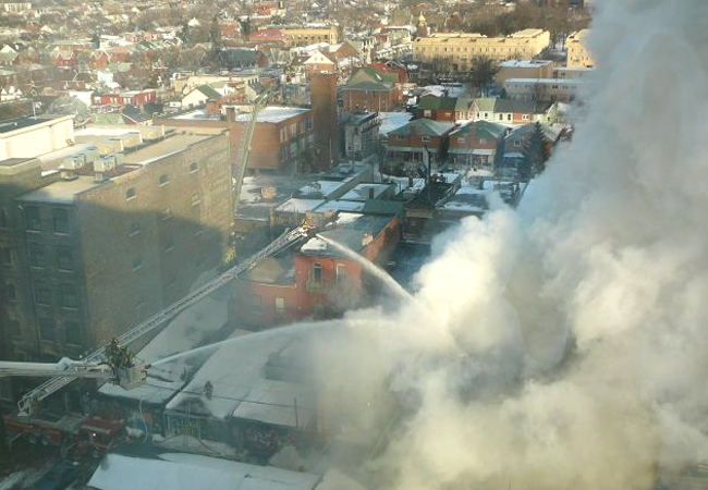 Firefighters battle the blaze on Queen Street West as seen from this 11th floor building in downtown Toronto on Wednesday, Feb. 20, 2008. (Katie Gawlik for CTV.ca)