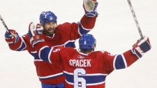 Montreal Canadiens Jaroslav Spacek, right, celebrates his second period goal with teammate Roman Hamrlik against the Pittsburg Penguins in Game 6 NHL Eastern Conference semi-final hockey action Monday, May 10, 2010 in Montreal. THE CANADIAN PRESS/Ryan Remiorz