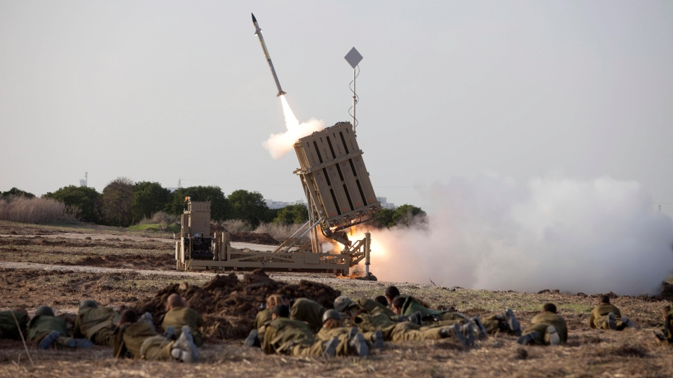 Israeli soldiers lie on the ground as an Iron Dome missile is launched near the city of Ashdod, Israel, Monday Nov 19. 2012. (AP / Moti Milrod)