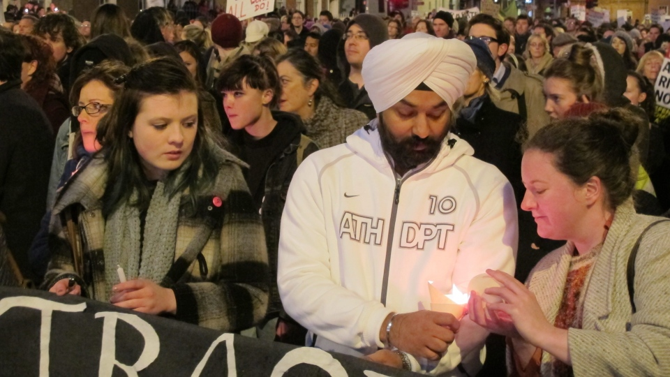 An Indian man and Irish woman light candles as abortion rights protesters march through central Dublin Saturday, Nov. 17, 2012. (AP / Shawn Pogatchnik)