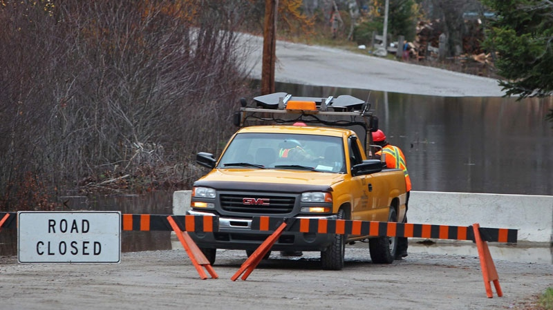 A section of road is closed to traffic along the Clyde River in South Western Nova Scotia on Tuesday, November 9th, 2010, as flood waters continue to surge after several days of heavy rain hit the province. (Mike Dembeck / THE CANADIAN PRESS)
