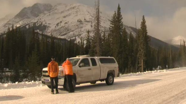 Public safety specialists keep an eye on the terrain from Spray Lakes Road south of Canmore.