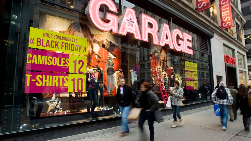 A store signs advertising Black Friday sales is shown in Montreal, November 26, 2011. (Graham Hughes / THE CANADIAN PRESS)