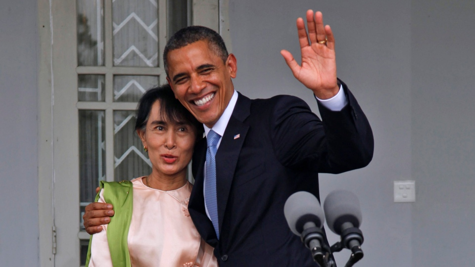 U.S. President Barack Obama waves his hand as he is pictured with Myanmar opposition leader Aung San Suu Kyi at her lakeside residence in Yangon, Myanmar, Monday, Nov.19, 2012. (AP / Khin Maung Win)