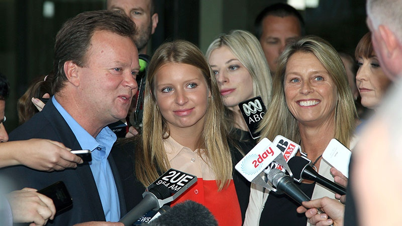 Madeleine Pulver center, stands with her father Bill, left, and mother Belinda, right, while speaking to the media outside the New South Wales State District Court, after the sentencing of Paul Douglas Peters, in Sydney, Australia, Tuesday, Nov. 20, 2012. (AP / Rob Griffith)