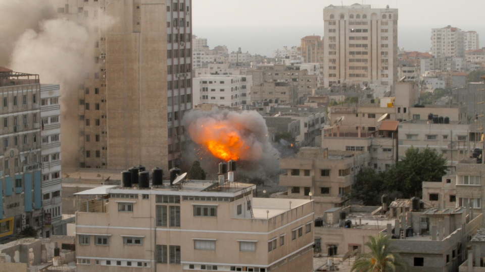 Smoke and fire are seen from an explosion by a high rise housing media organizations in Gaza City, Monday, Nov. 19, 2012. (AP / Hatem Moussa)