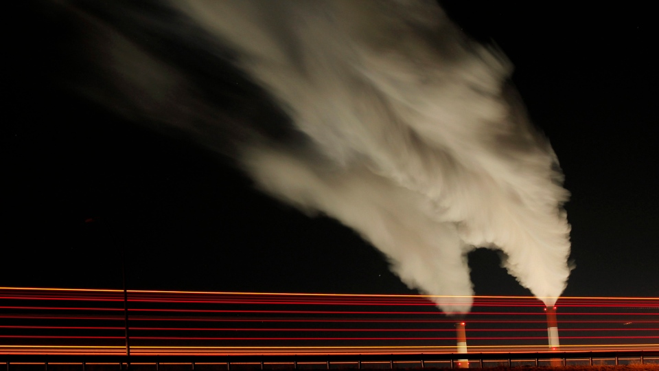 Smoke rises in this time exposure image from the stacks of the La Cygne Generating Station coal-fired power plant in La Cygne, Kansas, Jan. 19, 2012. (AP /Charlie Riedel)