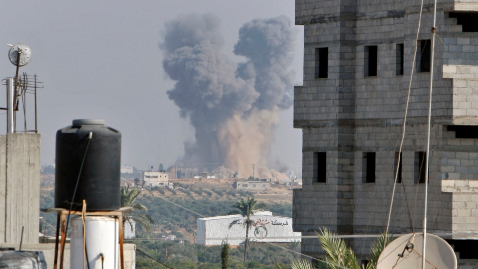 Smoke rises following an Israeli attack east of Gaza City, seen from Bureij refugee camp, central Gaza Strip, Tuesday, Nov. 20, 2012. (AP / Adel Hana)