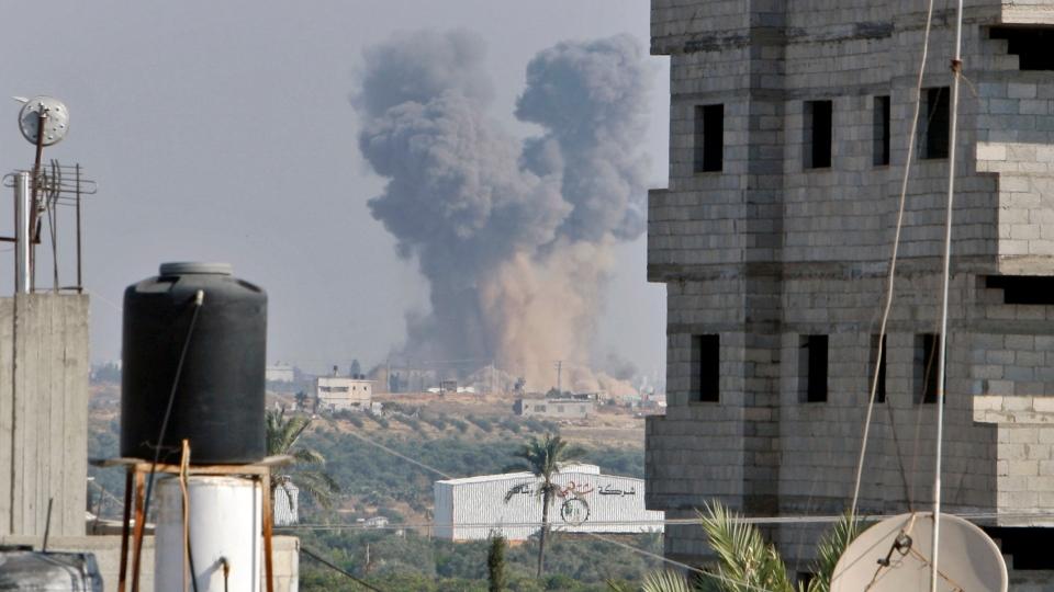 Smoke rises following an Israeli attack east of Gaza City, seen from Bureij refugee camp, central Gaza Strip, Tuesday, Nov. 20, 2012. (AP / Adel Hana)