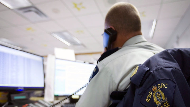 A worker takes a 911 call at the RCMP F Division Operational Communication Command Centre on Thursday, Sept. 16, 2010, in Regina, Sask. (Troy Fleece / THE CANADIAN PRESS)