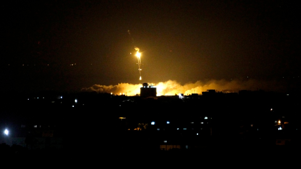 An Israeli illumination round is seen along the Israel and Gaza borders as it lights the sky east of Gaza City, on Tuesday, Nov. 20, 2012. (AP / Hatem Moussa)