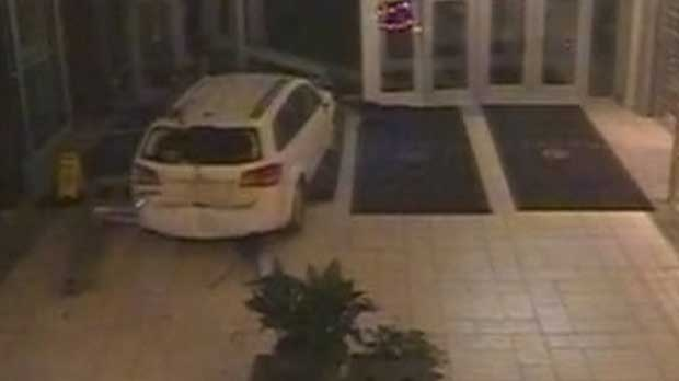 A capture from security camera footage shows a white Dodge Journey smashing through the north entrance of Market Mall on Nov. 5. (Supplied/Calgary Police)