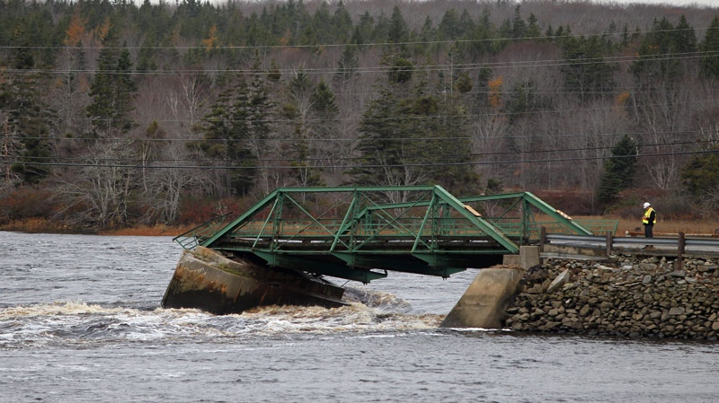The remains of a bridge bears the floodwaters of the Tusket River after collapsing as the river continued to spill its banks in Tusket, Nova Scotia on Wednesday, November 10, 2010. (Mike Dembeck / THE CANADIAN PRESS)